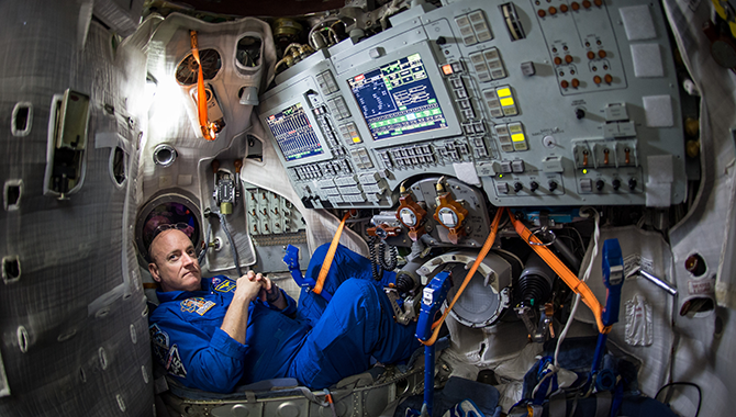 NASA astronaut Scott Kelly preparing for the One-Year Mission in a soyuz simulator at the Gagarin Cosmonaut Training Center. Photo Credit: NASA/Bill Ingalls