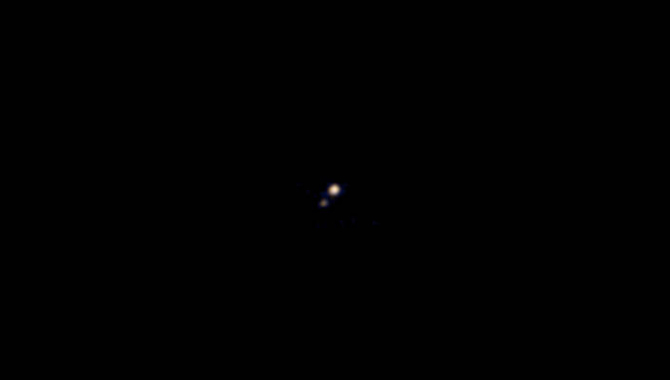 The first color image of Pluto and its largest moon, Charon, taken by the News Horizons spacecraft when it was still 71 million miles away. Photo Credit: NASA/Johns Hopkins University Applied Physics Laboratory/Southwest Research Institute