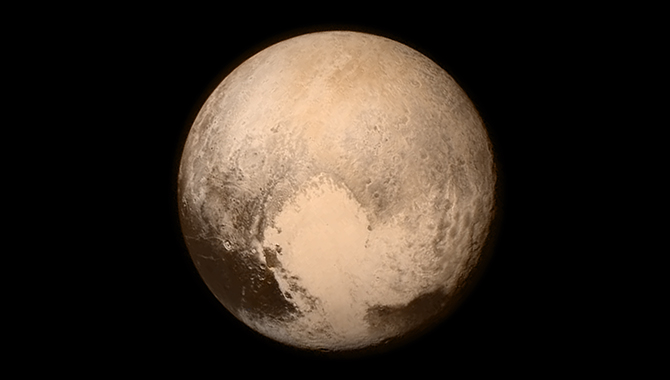 "Taken on July 13, 2015 by the New Horizons Long Range Reconnaissance Imager (LORRI), this image prominently features Pluto's ""heart"" feature, which is approximately 1,000 miles wide. Color was added from a separate image taken on the same day by the spacecraft's Ralph instrument. Photo Credit: NASA/APL/SwRI"