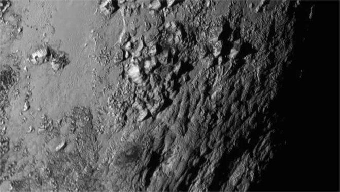 Close-up image of Pluto's surface reveals mountains that the team believes are composed of a bedrock of water ice and formed no more that 100 million years ago. Photo Credit: NASA-JHUAPL-SwRI
