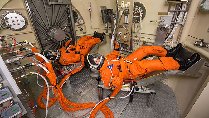 The spacesuit, known as the Modified Advanced Crew Escape Suit, that crew will wear during Orion deep space missions is tested at Johnson Space Center. Photo Credit: NASA/Bill Stafford
