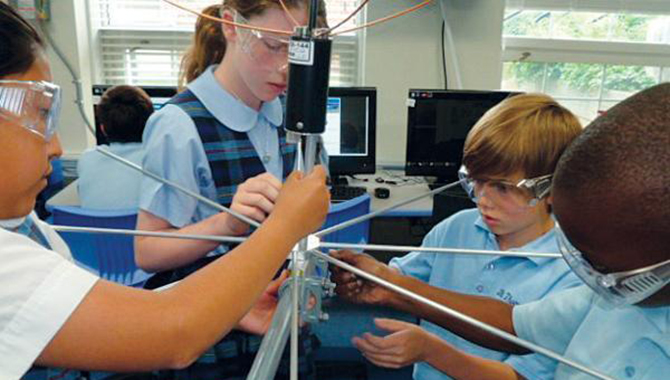 Students from the St. Thomas More Cathedral School work on the antenna that will enable the school to communicate with their satellite, the St. Thomas More Satellite (STMSat)-1. STMSat-1 was designed, built, and tested by elementary school students, and was launched to the ISS as part of NASA's ELaNa IX program. Image courtesy of STM.