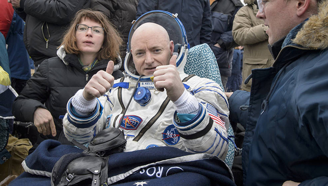 Scott Kelly, the first NASA astronaut to spend 12 months in space, shows the world he arrived home safely just moments after returning from the One Year Mission on the International Space Station. Photo Credit: Bill Ingalls