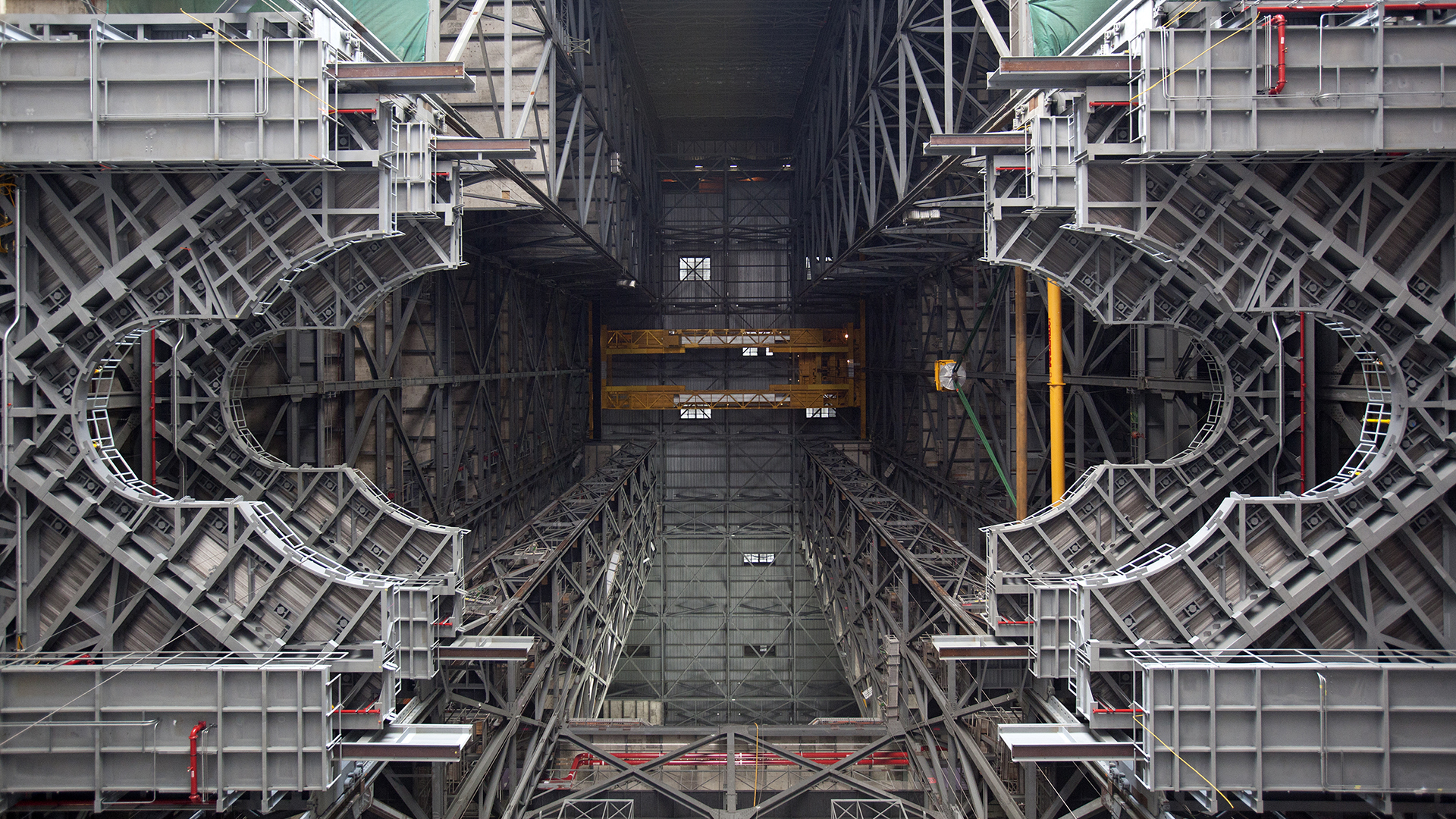 Photograph of the High Bay 3 in the Vehicle Assembly Building at Kennedy Space Center. Three work platforms, installed to provide access to the Space Launch System and Orion for EM-1, are visible. Photo Credit: NASA/Dimitri Gerondidakis