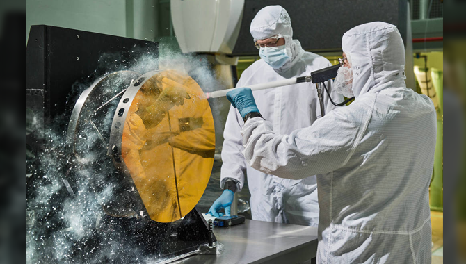 Engineers shoot carbon dioxide snow at a test version of a James Webb Space Telescope mirror to clean it without the risk of scratching it. Photo Credit: Chris Gunn