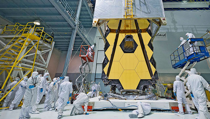 The James Webb Space Telescope (JWST) is now in the integration and test phase of development. In preparation for transport to testing areas, a clean tent is draped over the massive JWST primary mirror.