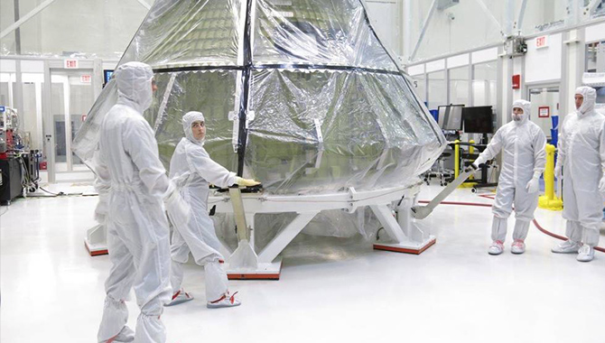 Work toward Exploration Mission 1 continues while the agency considers the pros and cons involved in adding crew to the mission. In this image, the Orion crew capsule was transferred to the clean room in the Neil Armstrong Operations and Checkout Building at Kennedy Space Center in July 2016. Credit: NASA