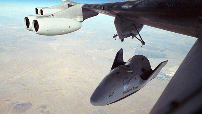 """On December 13, 2001, the V-131R dropped away from the wing of the B-52 """"mothership"""" for what turned out to be the longest and fastest flight of the X-38 program. Credit: NASA/Carla Thomas"""