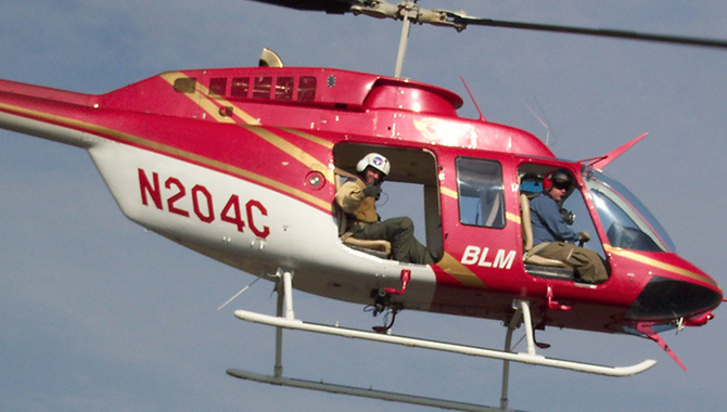 In the days and weeks after the Columbia accident in 2003, Michael Ciannilli helped with the recovery effort. In this image, he is seen in the back of a helicopter searching for pieces of the vehicle from the air. Credit: Michael Ciannilli