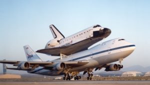 NASA's modified Boeing 747 Shuttle Carrier Aircraft with the Space Shuttle Endeavour on top lifts off to begin its ferry flight back to the Kennedy Space Center in Florida. Photo Credit: NASA
