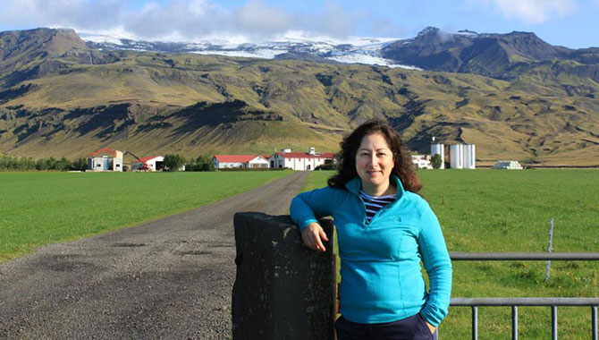 NEN Knowledge Services Lead Daria Topousis standing on a farm below the Eyjafjallajökull volcano in southern Iceland. Photo Credit: Daria Topousis