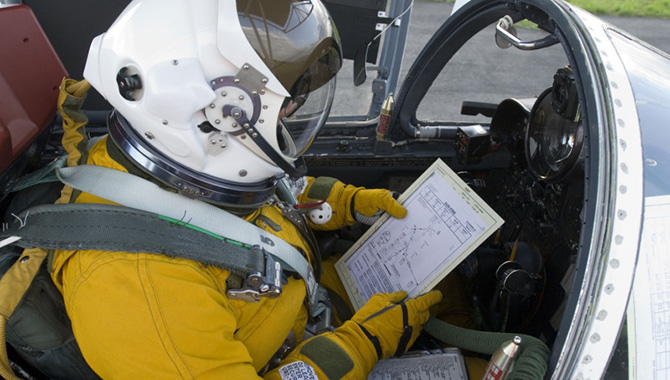 NASA pilot Dave Wright reviews pre-flight checklist prior to take-off. Photo Credit: NASA