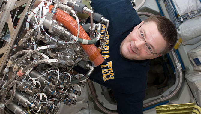 NASA Astronaut and Expedition 25 Commander Doug Wheelock works to install a system to extract more water out of the International Space Station atmosphere as part of the station's Environmental Control and Life Support System. Photo Credit: NASA