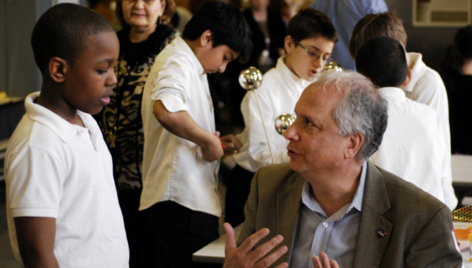 """Dr. Ed Hoffman, NASA Chief Knowledge Officer, talks with P.S. 199 5th grader. This aspiring young student explains to Dr. Hoffman that he will one day soon be his boss and he will have to do what he asks him to do… he says, """"I will be your boss one day."""" – CITYarts Inc. copyright. Project produced and created by CITYarts with the professional advice of Lewis Peach. Photo Credit: Photo courtesy of CITYarts, Inc. Photo taken by Berette Macaulay."""