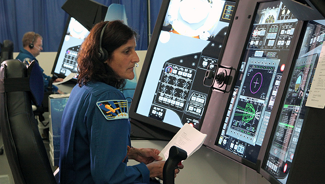 Commercial Crew Program astronauts Suni Williams, foreground, and Eric Boe practice docking operations for Boeing's CST-100 Starliner. Photo credit: NASA/Dimitri Gerondidakis