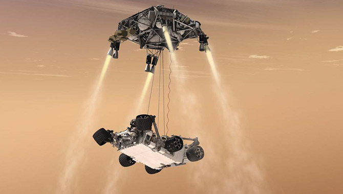 This artist's concept shows the sky crane maneuver during the descent of NASA's Curiosity rover to the Martian surface. Image Credit NASA