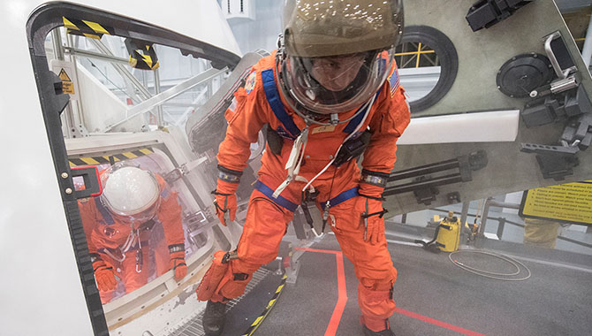 In the Space Vehicle Mockup Facility at JSC, engineers used fake smoke to simulate an emergency scenario in the Orion spacecraft. Astronauts then explored a scenario in which they exited the capsule while their vision was obscured. Credit: NASA/James Blair