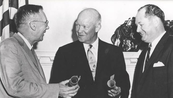 President Dwight D. Eisenhower (center) appoints T. Keith Glennan (right) NASA's first administrator and Hugh L. Dryden its first deputy administrator.
