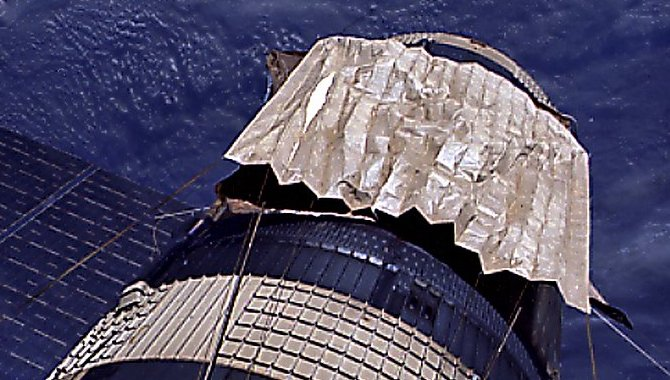The sunshade deployed by the crew of Skylab 3 showing the folds Pilot Jack R. Lousma wrestled with in zero gravity.]