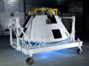 Sporting a fresh paint job, NASA's first Orion full-scale abort flight test crew module awaits avionics and other equipment installation. Credit: NASA