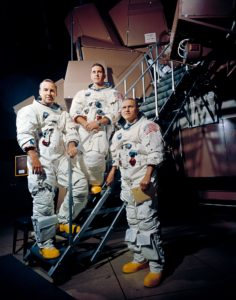 13 Nov. 1968–These three astronauts are the prime crew of the Apollo 8 lunar orbit mission. Left to right, are James A. Lovell Jr., command module pilot; William A. Anders, lunar module pilot; and Frank Borman, commander. They are standing beside the Apollo Mission Simulator at the Kennedy Space Center (KSC). Credit: NASA