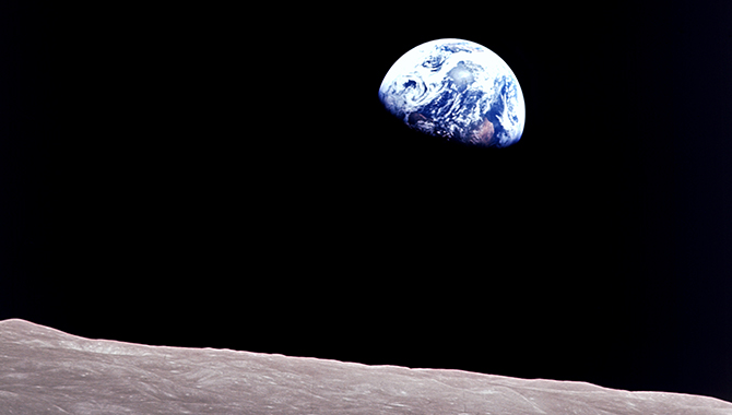 Taken aboard Apollo 8 by William A. Anders, this iconic picture shows Earth rising above the lunar surface as the first crewed spacecraft orbited the Moon. Credit: NASA