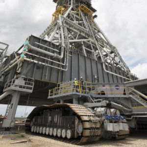 Crawler-transporter 2 (CT-2) is being moved under the mobile launcher May 31, 2018, at NASA's Kennedy Space Center in Florida. Three lifts will be performed to practice lifting procedures, validate interface locations, confirm the weight of the mobile launcher, and develop a baseline for modal analysis. The mobile launcher is equipped with a number of lines, called umbilicals, which will connect to NASA's Space Launch System (SLS) and Orion. CT-2 has been upgraded to handle the weight of the mobile launcher with SLS and Orion atop. Exploration Ground Systems is preparing the ground systems necessary to support the SLS and Orion spacecraft for Exploration Mission-1 and deep space missions. Credit: NASA