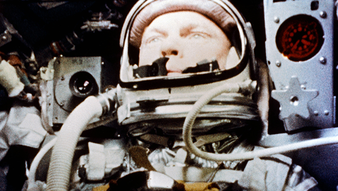 John H. Glenn Jr. during his historic flight in the tight Mercury spacecraft on February 20, 1962. Credit: NASA