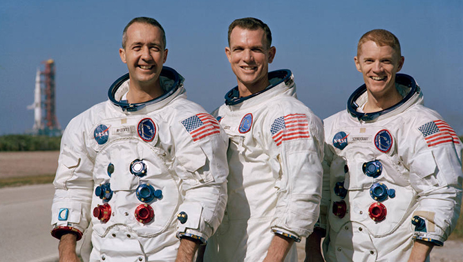 Apollo 9 crew, from left, James A. McDivitt, David R. Scott, and Russell L. Schweickart, posing in front of their Saturn V rocket at Kennedy Space Center's Launch Pad 39A. Credit: NASA
