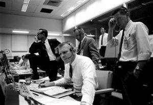 Lead Flight Director Kranz (seated) and managers and controllers monitor the Apollo 9 launch from Mission Control in Houston. Credit: NASA