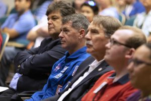 NASA astronaut Shane Kimbrough, blue flight suit, listens to a presentation in Kennedy Space Center's Training Auditorium on April 12, 2019. Credit: NASA