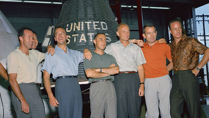 The original Mercury astronauts in June 1963 at the Manned Spacecraft Center (MSC), now Johnson Space Center, in Houston, Texas. From left-to-right: L. Gordon Cooper Jr., Walter M. Schirra Jr., Alan B. Shepard Jr., Virgil I. Grissom, John H. Glenn Jr., Donald K. (Deke) Slayton and M. Scott Carpenter. Credit: NASA