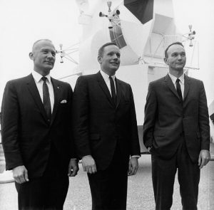 Aldrin, Armstrong and Collins pose in business suits following a press conference at the Manned Spacecraft Center. Credit: NASA