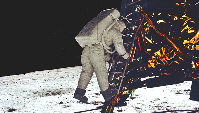 In this photograph, astronaut Edwin (Buzz) Aldrin takes his first step onto the surface of the Moon. Credit: NASA/Neil Armstrong