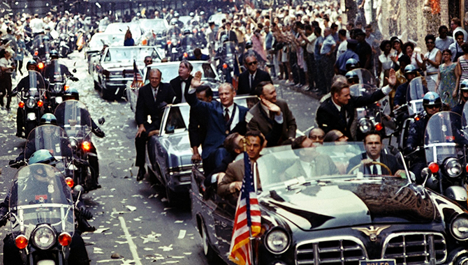 New York City welcomes Apollo 11 crewmen in a showering of ticker tape down Broadway and Park Avenue in a parade termed as the largest in the city's history. Pictured in the lead car, from the right, are astronauts Neil A. Armstrong, commander; Michael Collins, command module pilot; and Edwin E. Aldrin Jr., lunar module pilot. Credit: NASA/Bill Taub
