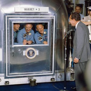 President Richard M. Nixon greets the Apollo 11 astronauts—(left to right) Neil A. Armstrong, commander; Michael Collins, command module pilot; and Edwin E. Aldrin Jr., lunar module pilot—in the Mobile Quarantine Facility. Credit: NASA