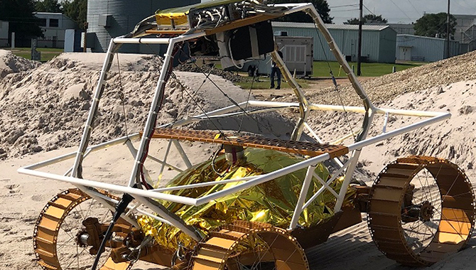 A VIPER engineering model is driven over slopes, textures and soils that simulate the lunar environment to test its mobility systems. Credit: NASA/Johnson Space Center