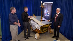 Vice President Mike Pence examines the VIPER engineering test unit with VIPER project manager and director of engineering at NASA's Ames Research Center Daniel Andrews (center) and VIPER project scientist Anthony Colaprete (left) at Ames on Thursday; in California's Silicon Valley. Thursday; Nov. 14, 2019. Credit: NASA/Dominic Hart