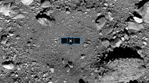 This image shows sample site Nightingale, OSIRIS-REx's primary sample collection site on asteroid Bennu. The image is overlaid with a graphic of the OSIRIS-REx spacecraft to illustrate the scale of the site. Credit: NASA/Goddard/University of Arizona