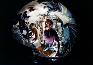 July 1970: A fish-eye lens view showing astronauts Alan B. Shepard Jr. (foreground) and Edgar D. Mitchell in the Apollo lunar module mission simulator at the Kennedy Space Center during preflight training for the Apollo 14 lunar landing mission. Credit: NASA