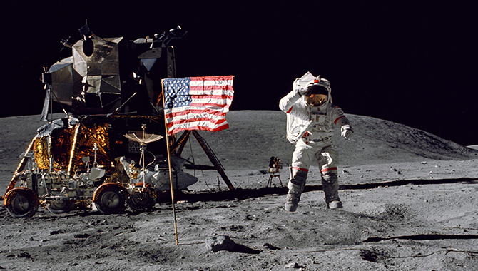 Apollo 16 Commander John W. Young salutes the United States flag during the mission's first extravehicular activity, with the Lunar Module and the Lunar Roving Vehicle in the background. Lunar Module Pilot Charles M. Duke, Jr. took the photo. Credit: NASA
