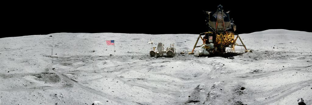 Panorama view of Apollo 16 commander Astronaut John W. Young, working at the Lunar Roving Vehicle (LRV) just prior to deployment of the Apollo Lunar Surface Experiments Package (ALSEP) during the first moonwalk of the mission on April 21, 1972. The panoramas were built by combining Apollo 16 images starting with frame AS16-116-18573 thru end frame AS16-116-18581. The panoramic images received minimal retouching by NASA imagery specialists, including the removal of lens flares that were problematic in stitching together the individual frames and blacking out the sky to the lunar horizon. These adjustments were made based on observations of the Moon walkers who reported that there are no stars visible in the sky due to the bright lunar surface reflection of the Sun. Credit: NASA