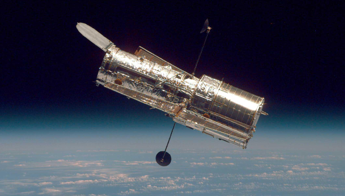The Hubble Space Telescope (HST) seen from the Space Shuttle Discovery. Credit: NASA