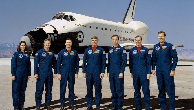 STS-49 crew poses for group portrait. Daniel C. Brandenstein, center, is mission commander; and Kevin P. Chilton, third from right, is pilot. Mission specialists are, left to right, Kathryn C. Thornton, Bruce E. Melnick, Pierre J. Thuot, Thomas D. Akers and Richard J. Hieb. Credit: NASA