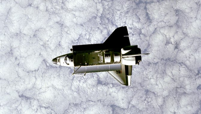 Space Shuttle Challenger, orbiting the Earth, as seen from a camera mounted on the first Shuttle Pallet Satellite. Credit: NASA