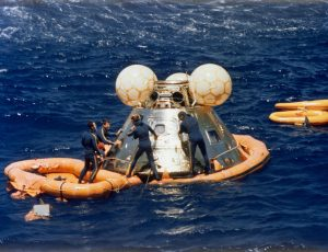 (24 July 1975)—A team of U.S. Navy swimmers assists with the recovery of the ASTP Apollo Command Module following its splashdown in the Central Pacific Ocean. Credit: NASA
