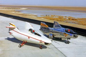 After the M2-F1 (left) proved the lifting-body concept, NASA and the Air Force began work on a series of heavyweight, rocket-powered lifting bodies able to reach supersonic speeds and altitudes up to 90,000 feet. The M2-F2 (on the right) was the first of these heavyweights. Credit: NASA