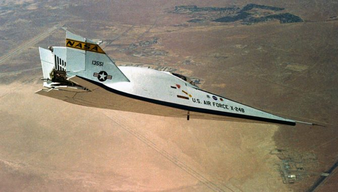 "The X-24B over the Mojave Desert near Edwards Air Force Base. The aircraft's unique shape earned it the nickname ""Flying Flatiron."" Credit: NASA"