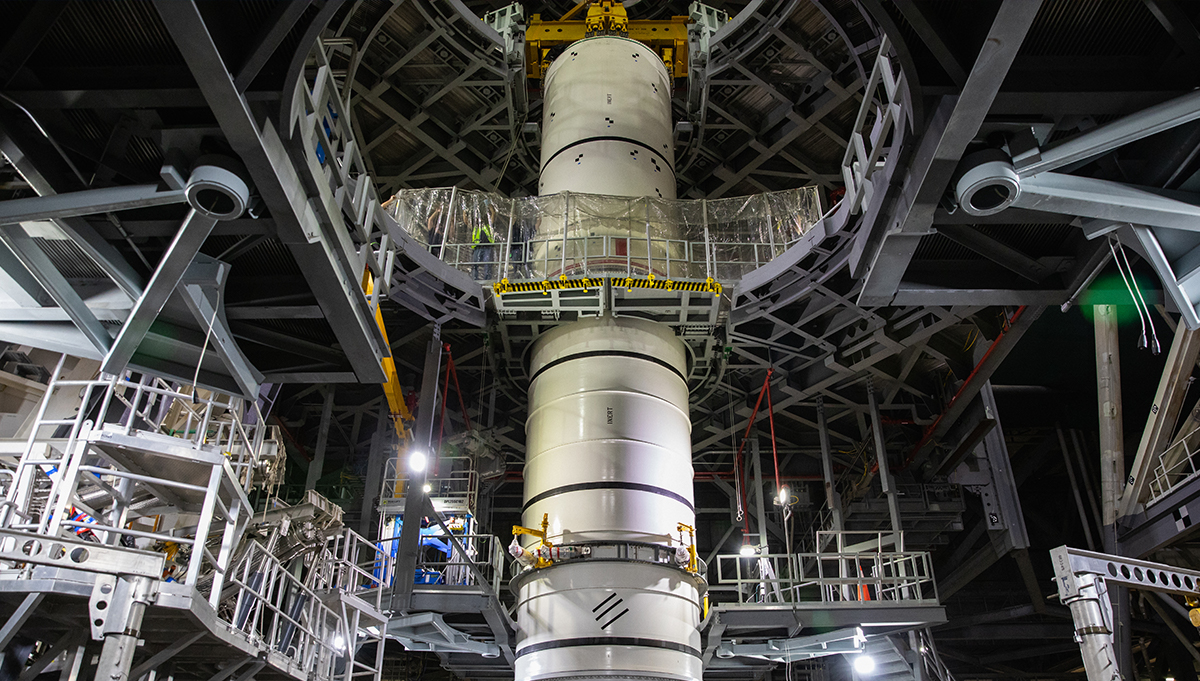 Earlier this year, technicians in the Vehicle Assembly Building (VAB) at Kennedy Space Center rehearsed stacking Artemis I's booster rockets using full-scale replicas known as pathfinders. Credit: NASA