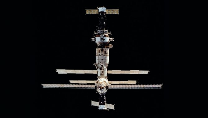 The Russian space station Mir as Space Shuttle Discovery pulls closer for the first rendezvous in a program that would eventually include nine docking missions. Credit: NASA/JSC